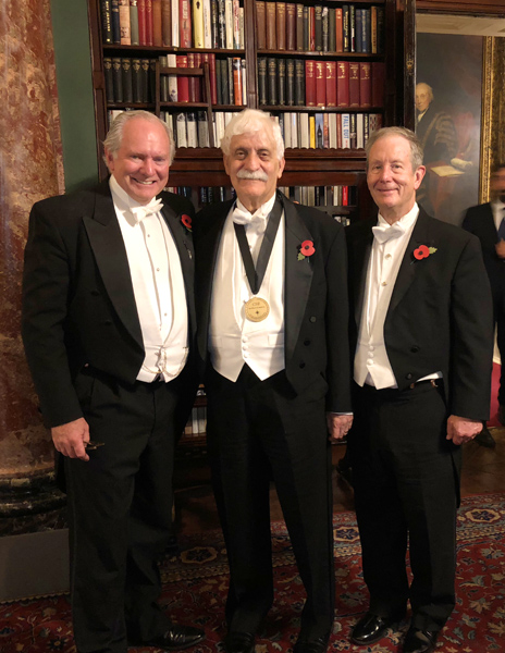 ProfessorRaymond Damadian, M.D. at Brooks's in London, England, wearing the Excellence in Medicine medal awarded him by the Chiari and Syringomyelia Foundation. Standing with him is Professor Fraser Henderson, M.D. (left) and Daniel Culver, Fonar Corporation Director of Communications (right).