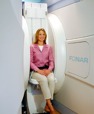 Patient in the FONAR UPRIGHT® Multi-Position™ MRI